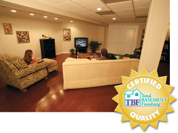 A remodeled basement with the Total Basement Finishing™ badge